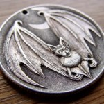 'Bat' carveing in a silver USA 1964 (Kennedy silver half $) 2