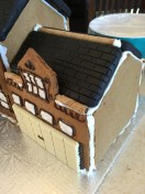 Rolled wafer cookies placed around garage and on the top. Next comes the fondant.