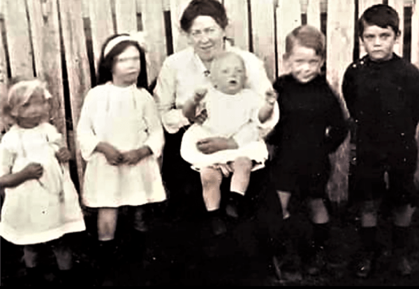 Nora Larcombe and her children at Reedy Marsh.