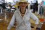 Pauline Conolly trying on hats in Sydney