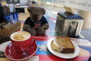 Editor Des enjoys coffee and cake.