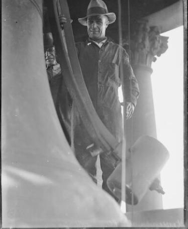 Steeplejack beside the hour bell of Sydney G.P.O. clock