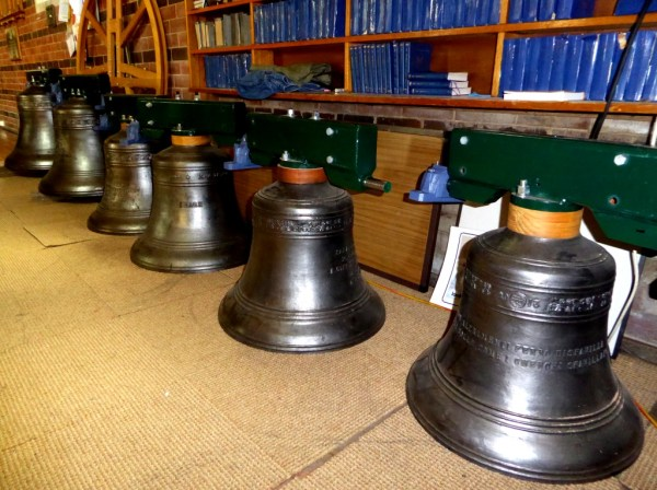 The entire peal of bells awaiting installation.