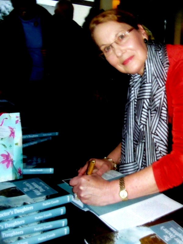 Pauline Conolly signing books.