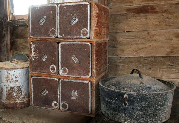 Depression era kitchen featuring kerosine tins