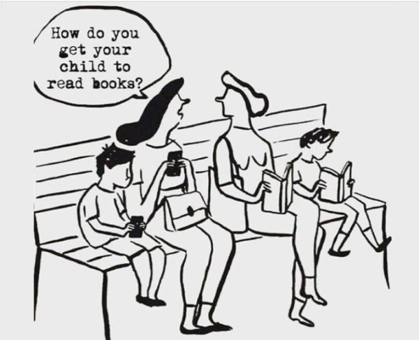 Mothers on a bench, one a phone addict, one a book lover.