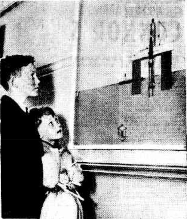 Children surveying a Tanner painting.