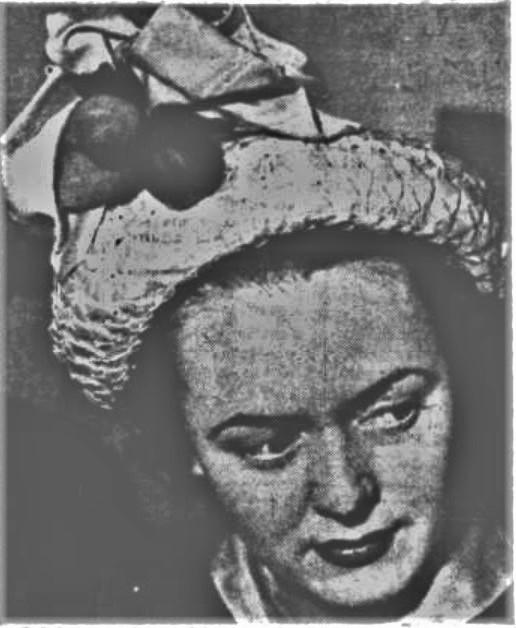 Mrs Joy Burnham wearing a hat she purchased in America while on her honeymoon.
