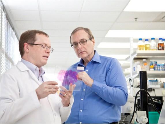 Paul G. Allen studies a brain sample with Allen Institute for Brain Science CEO Allan Jones.