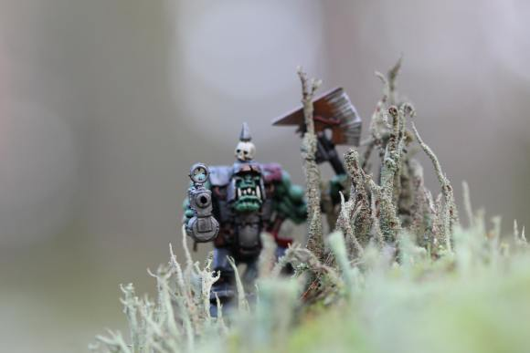 Closeup photo of a toy monster with a gun