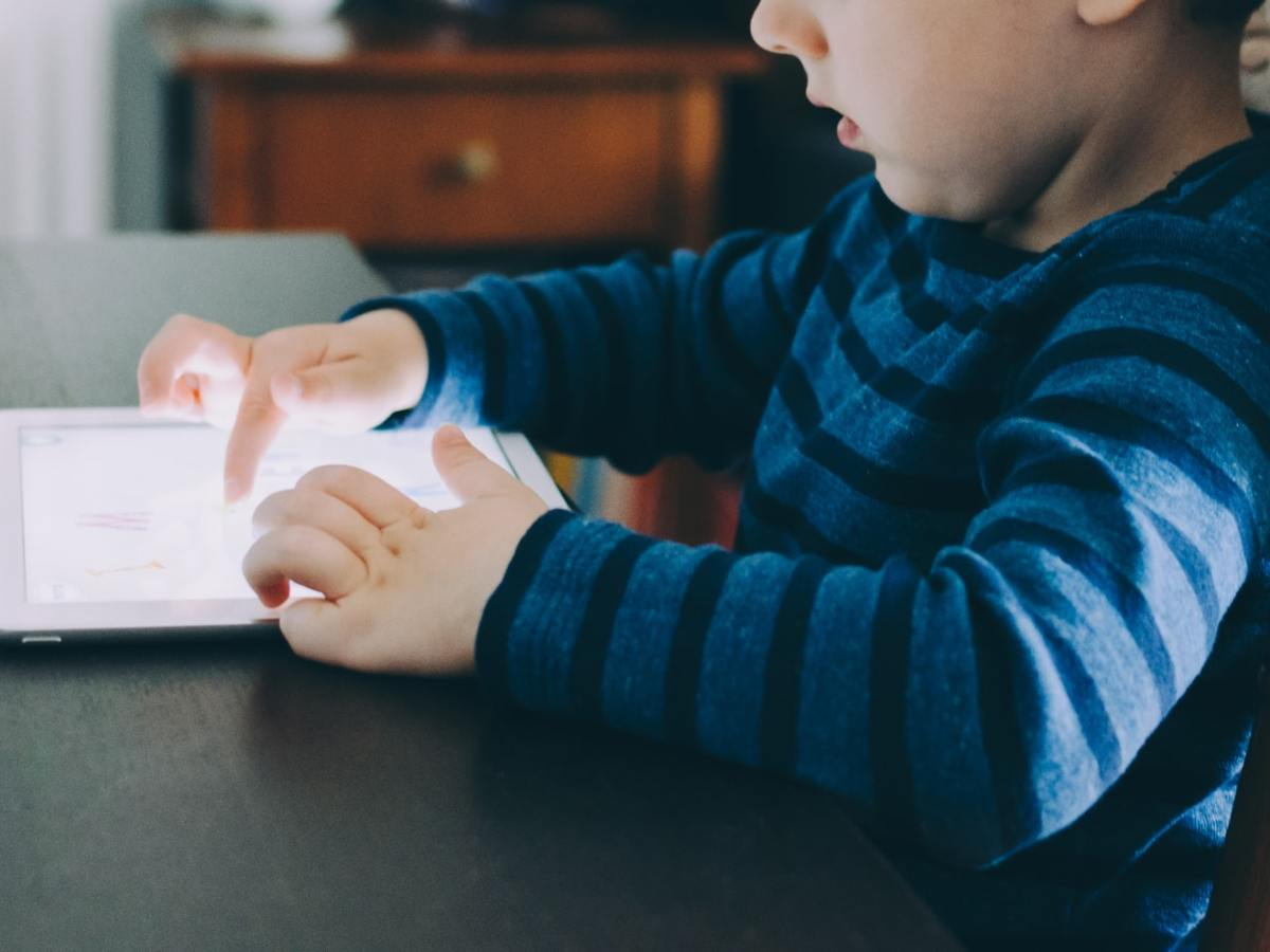 Child looking at a tablet device