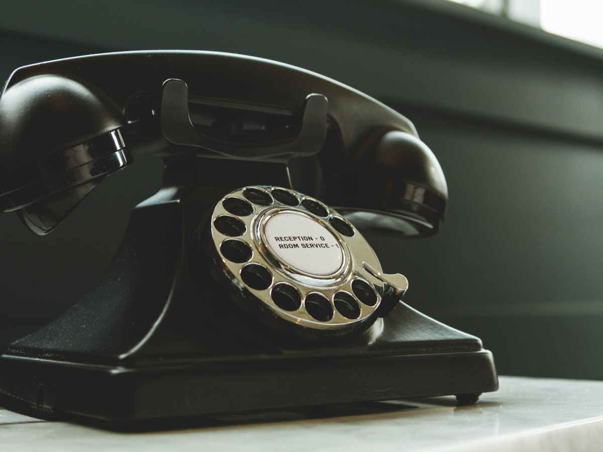 Black, old-style phone on a counter