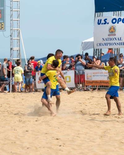 Maryzillians beach sand soccer club celebrate their 7 to 5 win over Great Lakes Beach Soccer club.