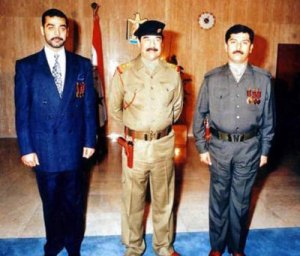Saddam Hussein with his two sons