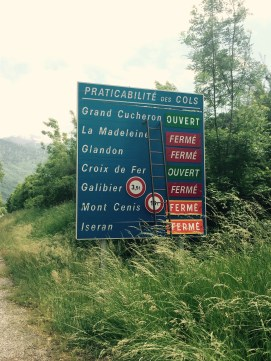 Road sign with state of local Alps passes