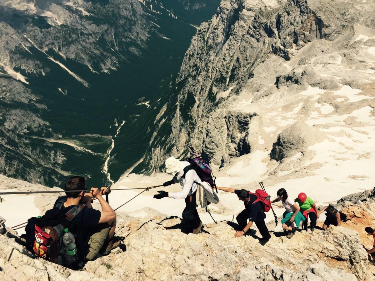 Nils Raabe waiting to descend the ridge, Triglav