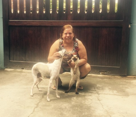 Generous host in Iguape with cat and dog, Brazil