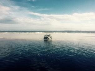Lagoon and bike on beach near Superagui, Brazil