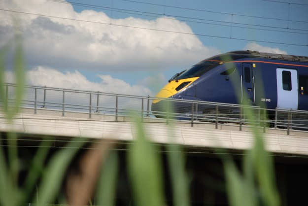 High speed Javelin train on the HS1 track above Rainham Marshes bird sanctuary in Essex