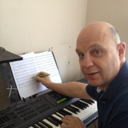 Paul Noble at work composing at home