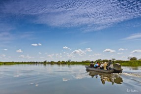 A peaceful and scenic flat-bottomed boat ride on the Okavango River.