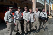 Adrien Brody (2nd from left) and Mika Salo (4th from left) with crew members