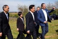 H.E.Mr. Zhang Chunxian 张春贤, Member of the Political Bureau of the CPC Central Committee, Deputy Head of Central Leadership Group on Party Building and H.E. Li Manchang 李满长 the ambassador of PR of China in Belgrade are visiting Fruskogorski vinogradi vineyards with Mr. Pavle Basic 帕夫莱·巴西期.