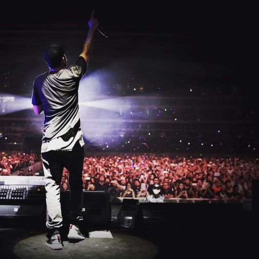 Mike Shinoda on a stage