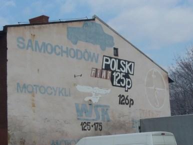 stary baner reklamowy na ścianie budynku w cieszynie