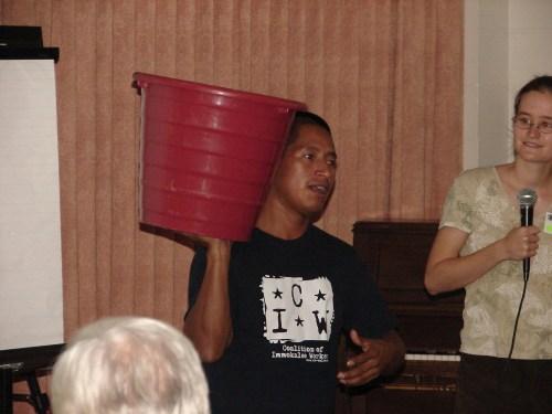 CIW member Romeo Ramirez with tomato bucket