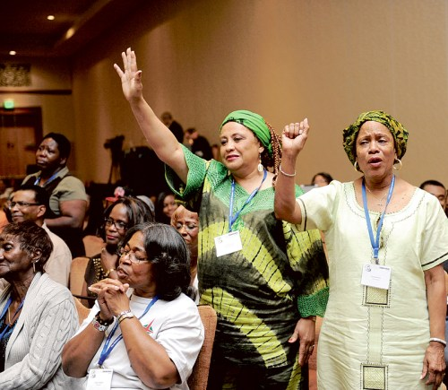 WOMEN SHOW EXUBERANCE DURING GOSPEL CONCERT AT NATIONAL BLACK CATHOLIC CONGRESS
