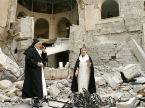 Iraqi sisters look over the damage at a church in northern Iraq.