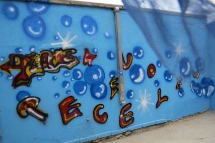 The graffiti, 'We Love Peace', on the wall of Borderfree Community Center of Nonviolence. (photo courtesy of Kathy Kelly)