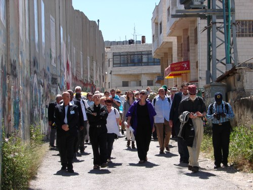 Pax Christi International members process along the Separation Wall in Bethlehem in the Occupied West Bank.