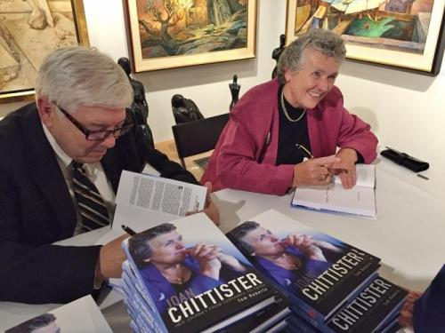 Tom Roberts, author of a biography of Benedictine Sr. Joan Chittister released Oct. 1, sign books with her at a launch event at Pucker Gallery in Boston. (GSR photo / Caitlin Hendel)