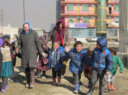 Kathy Kelly and Maya Evans with chiildren at Chamin e Babrak refugee camp in Kabul Photo Credit Abdulhai Darya