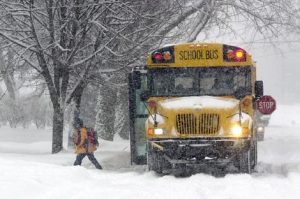 A lone student exits a school bus on Parker Avenue Tuesday, Jan. 27, 2004, during a snow storm in Elkhart, Ind. (AP Photo/The Truth, Jennifer Shephard) ORG XMIT: INELK102