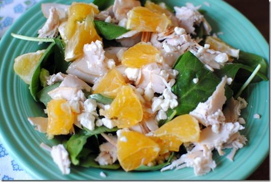 Salad with spinach, turkey, orange and feta