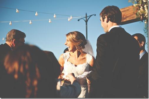 handing bride tissues at alter