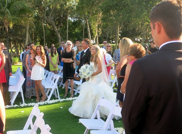 father of the bride escorting daughter