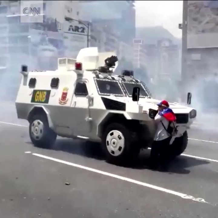 Woman stands down armored vehicle amid protests in the streets of Caracas, Venezuela