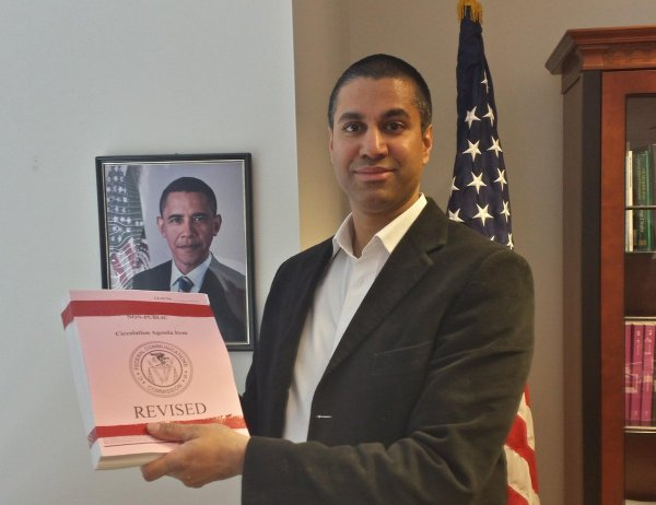 FCC Commissioner Ajit Pai shows off the 317 page plan that the public still can't see. Image links to story on NewsMax.com