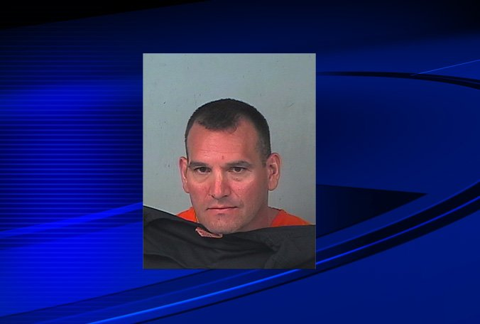 Man charged in peeping Tom case. Deputies say he left son at home while he went on a 'walk.'
