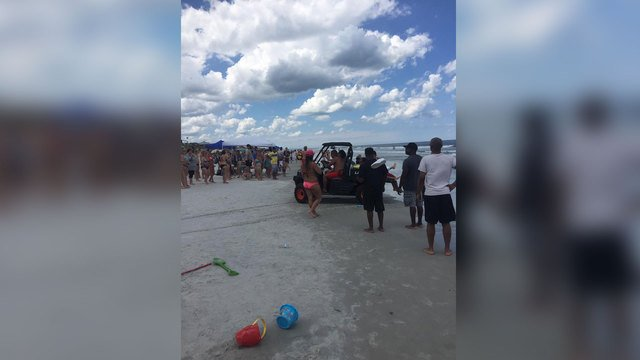 13-year-old boy bitten by shark at...