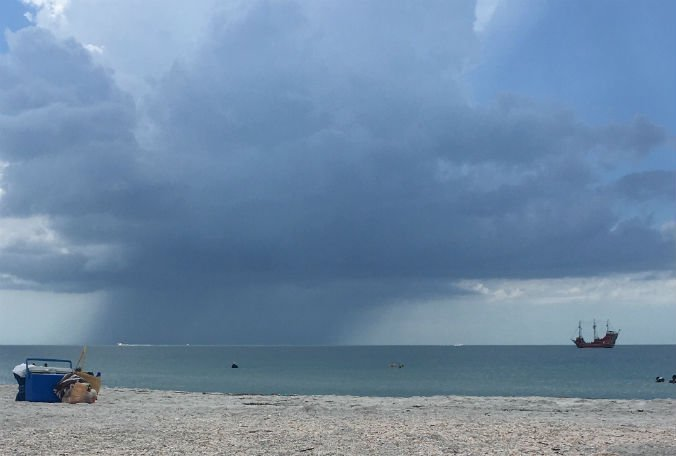 Thick clouds over Sand Key Park on Friday. More storms expected today. (Photo: Brittany)