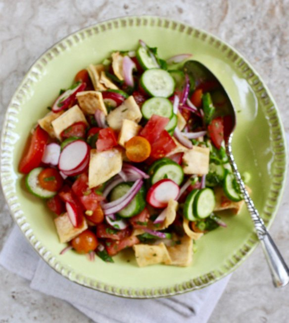 Tomatoes, cukes, plenty of mint, and toasted pita go into Middle Eastern fattoush.