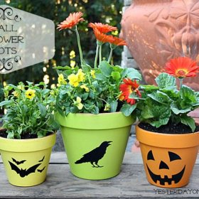Turn our clay pots from plain to these & here's how. halloween flowerpots craft diy
