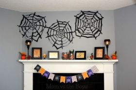 DIY large trash bag spiderwebs - fun decorating idea for Halloween momvstheboys