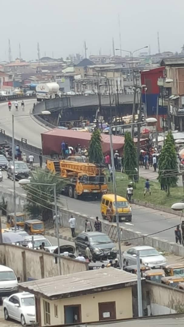D59sR1RWsAAVICA - Just In: Another Container Falls On Ojuelegba Bridge(Photos)