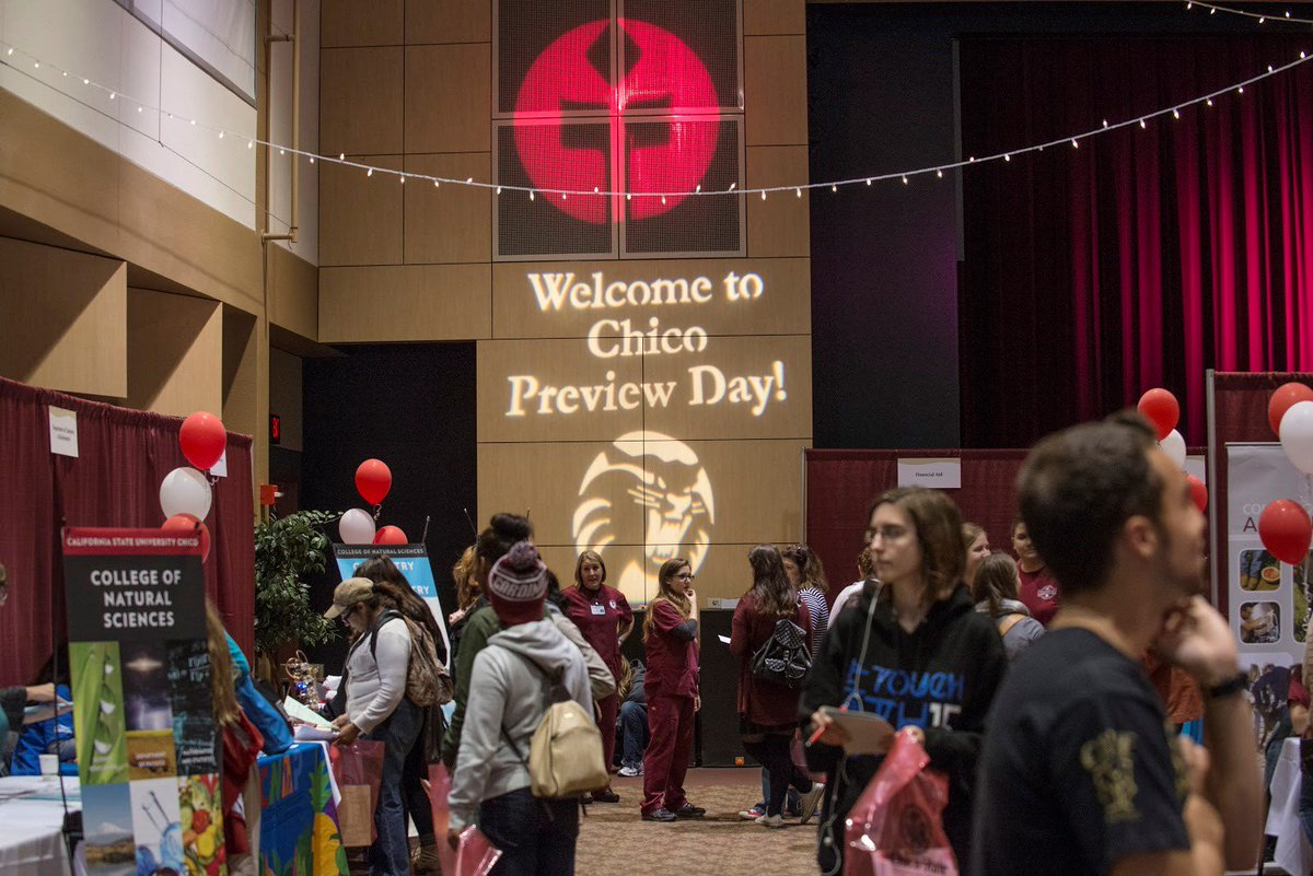 """Booths and tables for various on-campus clubs, with a sign reading """"Welcome to Chico Preview Day."""""""